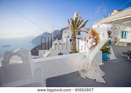 Beautiful Young Couple In Wedding Dress With A Long Veil Santorini