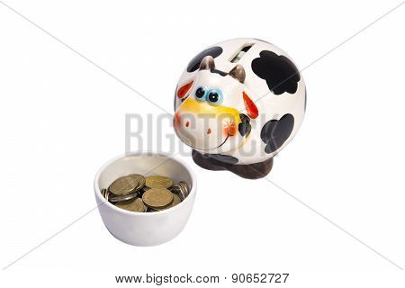 Cow A Moneybox Before A Feeding Trough