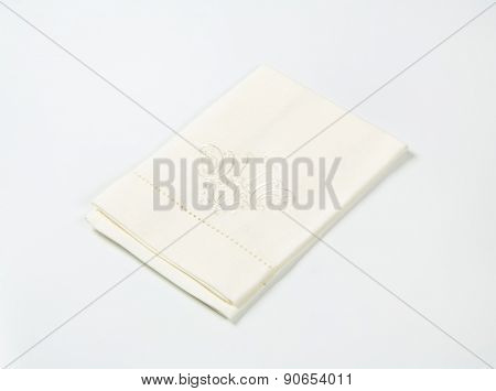 white decorative tablecloth on white background