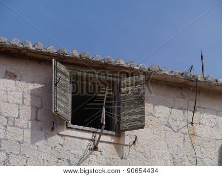 A Croatian house with brown shutters
