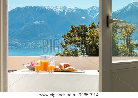 traditional breakfast on the balcony of a house, lake view