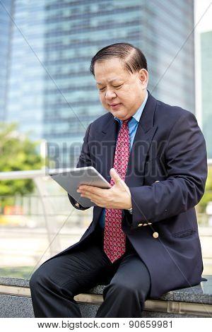 Asian businessman using tablet PC