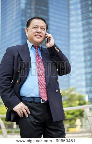 Asian businessman talking on smart phone
