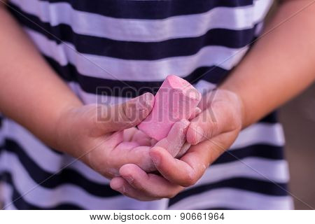 Small Child's Hand Holding Chalk