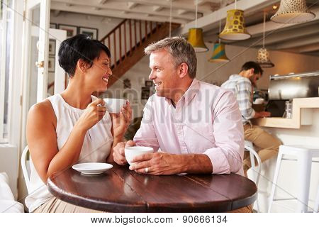 Middle aged people meeting in a cafe