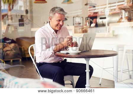 Middle aged man sitting in a cafe