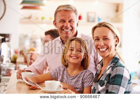 Happy family in a cafe
