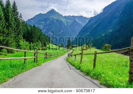 High peaks of the Alps with coutry road,  Austria