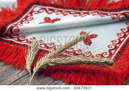 spikelets of wheat lie on towel