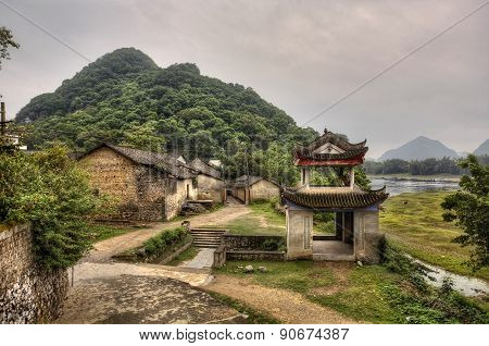 Stone Arbor Pagoda  At Entrance To Mountain Village, Rural China.