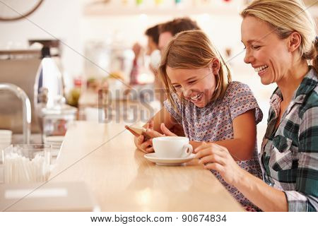 Mother and daughter in a cafe