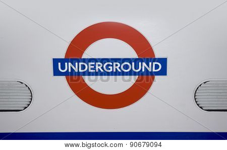 LONDON, England - May 10, 2015: Close up of a traditional station sign for the London Underground transportation systems, The sign was first used in 1908.