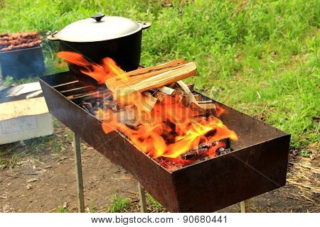 Pot on the fire grill