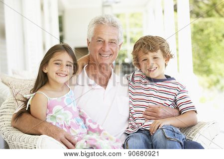 Grandfather With Grandchildren At Home