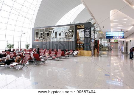 DUBAI, UAE - MARCH 10, 2015: DXB airport interior. Dubai International Airport is the primary airport serving Dubai, and is the world's busiest airport by international passenger traffic.