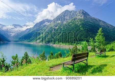 Empty bench and mountain lake, Zillertal, Austria