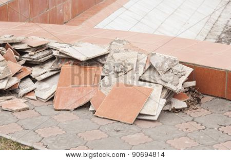 A pile of trash, various disposed, broken tiles