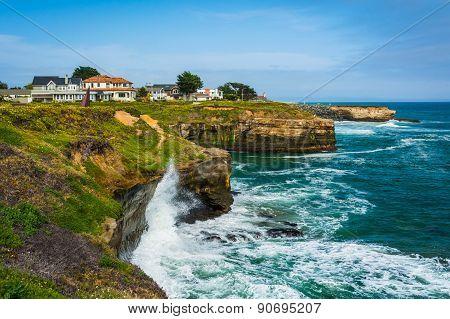 Waves Crashing On Cliffs Along The Pacific Ocean, In Santa Cruz, California.
