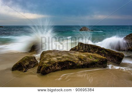 Waves Crashing On Rocks At Woods Cove, In Laguna Beach, California.