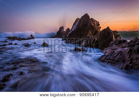 Waves Crashing On Rocks At Sunset, In Corona Del Mar, California.
