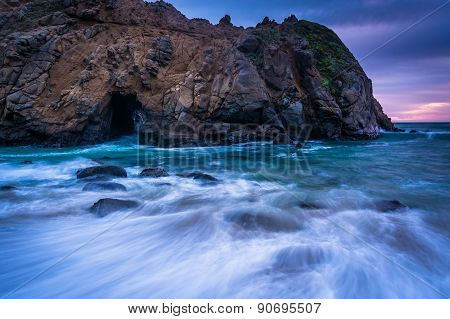 Waves In The Pacific Ocean And The Keyhole Rock At Pfeiffer Beach, In Big Sur, California.