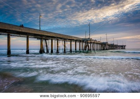 Waves In The Pacific Ocean And The Pier At Sunset, In Venice Beach, Los Angeles, California.