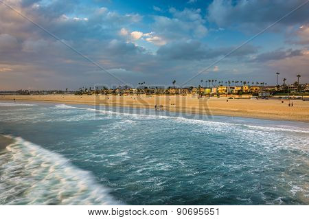 Waves In The Pacific Ocean And View Of The Beach At Sunset In Seal Beach, California.