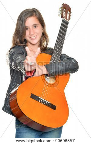 Trendy hispanic teenage girl carrying a guitar and doing the victory sign isolated on white