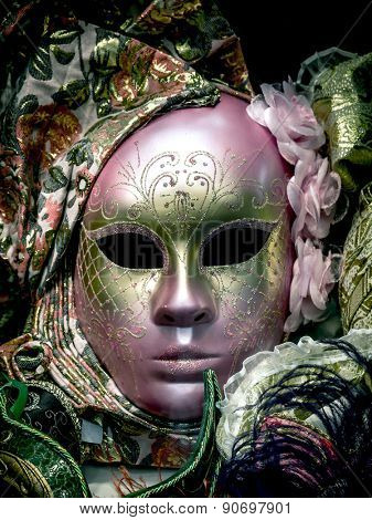 Pink Venetian mask on black background