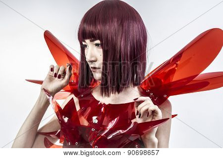 Japanese woman in costume of red plastic, modern and future concept