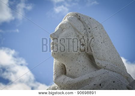 sculpture of a woman praying.Cerro de los Angeles is located in the municipality of Getafe, Madrid. It is considered the geographic center of the Iberian Peninsula