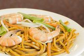 image of chinese wok  - Authentic Chinese Shrimp lo mein noodles at a restaurant - JPG