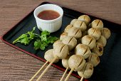 foto of meatball  - Food and Cuisine Grilled Meatballs on Wooden Skewer Served with Spicy Sauce - JPG