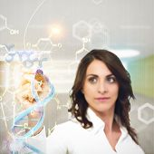 stock photo of chemical reaction  - Woman chemist explain chemical formulas in laboratory - JPG