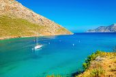 image of greeks  - Yacht standing in the middle of silent bay on Greek sea - JPG