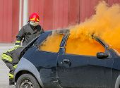 Постер, плакат: Practice Of Firefighters In The Firehouse And Simulation Of Traffic Accident