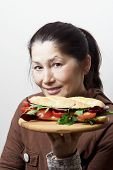 pic of tomato sandwich  - Woman with a sandwich with tomatoes - JPG