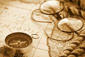 stock photo of decoupage  - Compass and glasses on vintage map - JPG