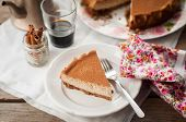 stock photo of cheesecake  - A Slice of Spiced Coffee Cheesecake Dusted with Cocoa Powder copy space for your text - JPG