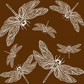 image of dragonflies  - openwork pattern of a dragonfly on a chocolate background - JPG
