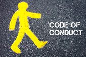 image of conduction  - Yellow pedestrian figure on the road walking towards CODE OF CONDUCT - JPG
