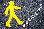 foto of pedestrians  - Yellow pedestrian figure on the road walking towards SUCCESS - JPG