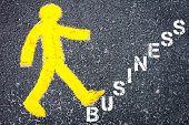 image of pedestrians  - Yellow pedestrian figure on the road walking towards BUSINESS - JPG