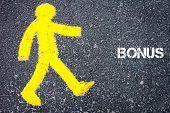 stock photo of pedestrians  - Yellow pedestrian figure on the road walking towards BONUS - JPG