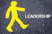 stock photo of pedestrians  - Yellow pedestrian figure on the road walking towards LEADERSHIP - JPG