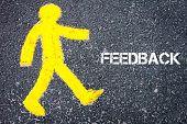 foto of pedestrians  - Yellow pedestrian figure on the road walking towards FEEDBACK - JPG