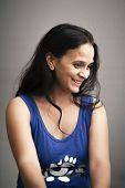 stock photo of shy girl  - Shy smile of beautiful Indian girl - JPG