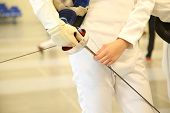 picture of rapier  - fencer with fencing mask and rapier - JPG