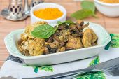 image of curry chicken  - stew chicken in curry with mushrooms on wooden table - JPG