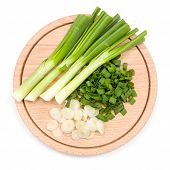 pic of cutting board  - Freshly cut green onion on wooden cutting board - JPG